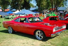 This red beauty is a 1968 Plymouth Roadrunner. Shes got a 440 with a Tremic 5 speed transmission.
