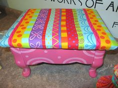 Footstool from becolorful.typepad.com from sf: not sure if this is padding with fabric over it - or if it's painted.....can't tell. It's awesome though. I love it - a cute little footstool!