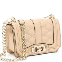 "SoldHOST PICKREBECCA Minkoff mini love 100% Leather Imported Textile lining Turn-lock closure 22.75"" shoulder drop 4.5"" high 6.75"" wide Interior slip pocket. Exterior pocket.                       Color: Biscuit                                                           Follow me @ Ⓜ️ and Instagram @joyr3025 Thanks LadiesPrice FIRM Rebecca Minkoff Bags Mini Bags"