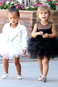 May 28 Kim Kardashian-West and Kanye West's daughter North attends a ballet class with her cousin Penelope Disick, where the twosome re-enacted their own version of Swan Lake in their contrasting costumes.