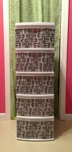 Use decorative duck tape to enhance those boring clear drawers on a storage bin.