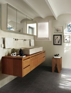 natural tone bathroom, wood vanity and dark floor