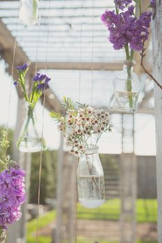 hanging flowers in bud vases - photo by Maria Mack Photography http://ruffledblog.com/forest-inspired-wedding-at-terrain