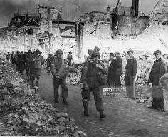 American troops retreating through the ruins of Nijmegen after failure of…