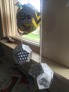 Middle - High School Baldwinsville Christian Academy art lesson Dodecahedrons using all art elements and principles, one for each side - all put in to a mobile to hang
