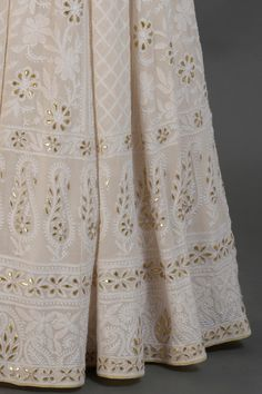 From our Bridal Heritage Collection, thistimeless Ivory gold outfit presenting a beautiful fusion of heritage thread crafts Chikankari, Gota Patti, Mirror Work and Zardozi. The lehenga skirt has floral and Half Saree Designs, Bridal Blouse Designs, Saree Blouse Designs, Gold Lehenga, Lehenga Skirt, Choli Dress, Blouse Dress, Zardozi Embroidery, Embroidery Suits