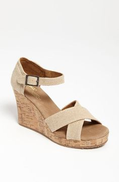 Free shipping and returns on TOMS 'Sierra' Wedge Sandal at Nordstrom.com. A comfy cork wedge boosts a cross-strap sandal finished in a breezy weave. <br><br>Since Blake Mycoskie started TOMS in 2006, the company has given away 10 million shoes to children in need across the globe through sales of their now-iconic shoes and their innovative 1-for-1 donation program.