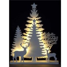 This wooden silhouette with Trees & Stags casts a unique shape thanks to the ice white LEDs built into the base. The LEDs are battery-powered, and last 500 times longer than standard bulbs to deliver long-lastsing performance with low power draw. Best Christmas Lights, Led Christmas Tree, Xmas Lights, Wooden Christmas Trees, Wooden Tree, Magical Christmas, Christmas Crafts, Merry Christmas, Christmas Ornaments