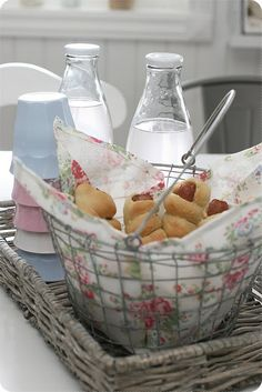 Love the wire basket lined with delicate floral fabric. Nice idea for a Mother's Day brunch.