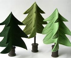 ..three felt evergreen trees standing on wooden spools, made from OhMa dyed wool felt in shades of green. Forest green tree stands 8 1/2 tall, grass