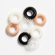 These cute coils are strong enough to hold your hair in place and comfortable enough to wear around your wrist. Hair Rubber Bands, Elastic Hair Bands, Coil Hair Ties, Fashion Accessories, Hair Accessories, Hair Supplies, Accesorios Casual, Girly Outfits, Styling Tools