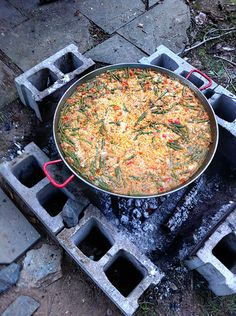 Every 4th of July, my friend Timothy Chegwidden cooks two huge paellas, Spain's famous rice dish, for a gathering of friends and their children. Tim makes