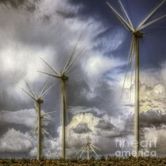 A group of six wind turbines stand against a background of large cumulus clouds that threaten more severe weather. The image is a multiple exposure which resulted in the ghosting of the propellers because they were moving slowly. It's finished with a light airy glazing as a tribute and in respect of the air that we breathe.   The photograph was taken on a late June afternoon at the rest stop off I90, the top of Rye Grass pass, Washington State.
