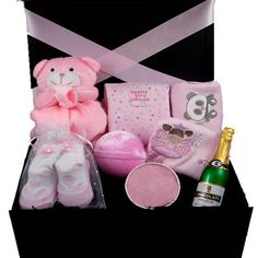 """This """"baby & mum relaxing"""" gift box hamper comes filled with quality and luxury pink or blue items, which are gorgeous, soft to touch and 100% cotton. Also included are some lovely bath treats for mum and some celebration chocolate champagne. A special unique gift for any new parent (pink or blue)"""