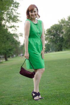 Green #JCrew dress with deep purple accessories.