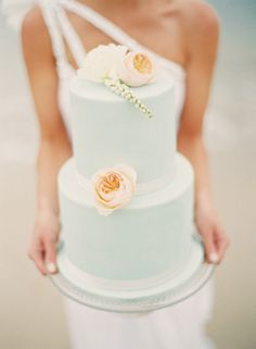 simple pastel wedding cake with flowers