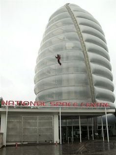 Day 45 of the Torch Relay begins at the National Space Centre as stuntman Eric Scott carries the Olympic Flame in the sky using a jet pack.