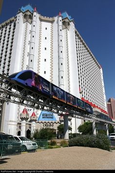 """The """"One"""" Cirque du Soliel Doppelmayr Cable Liner that runs as the Mandalay Bay to Excalibur express tram passes the Excalibur Casino."""