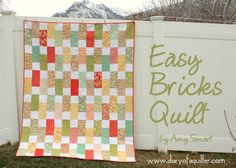 Today I am sharing a tutorial over at Moda Bake Shop with simple steps to make this easy Bricks quilt. I love the simplicity of this quilt and using the Bella Solid Charm Packs and the Layer Cakes makes the quilt come together SO quickly. It's a great quilt for beginners or anyone who needs to make a good-looking quilt, fast. It works well in lots of different types of fabric too. Here is a version I made out of Denyse Schmidt's Hope Valley last summer. The fabric choice can take this look…