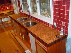 Custom solid wood Hard Maple end grain counter top with solid end grain Walnut trim and double under-mount sink