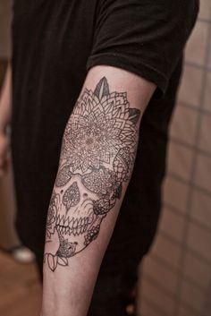Skull and Lotus arm tattoo