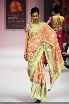 A model showcases a creation by designer Ashok Maanay at Blenders Pride Bangalore Fashion Week (BPBFW) 2013