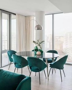Withholding nothing, we pulled out all the stops for this two bedroom apartment's bold color palette. Check out this eye-catching space from featuring our Orb Velvet Dining Chairs + Arden Dining Table!Teal and cream dining room with mid century mod Mid Century Modern Dining Room, Modern Dining Room Tables, Luxury Dining Room, Mid Century Dining Chairs, Dining Room Design, Dining Room Chairs, Dining Room Furniture, Design Room, Office Chairs