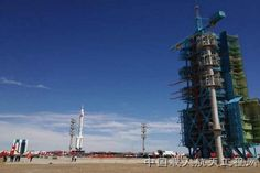 A Long March 2F rocket carrying the Shenzhou 9 rocket rolls out to the launch pad at Chinas Jiuquan Satellite Launch Center ahead of a planned June 2012 launch of the countrys first manned space docking mission.