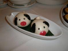 Pig shaped Steamed Sweet Sesame Bun. Blog also has pictures of rabbit, ladybug, penguin, and crab dumplings.