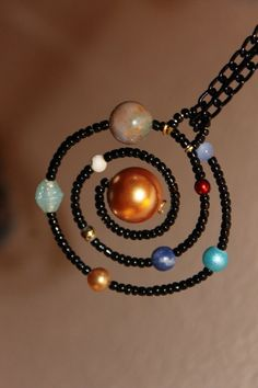 Solar system necklace. That is gloriously geeky.