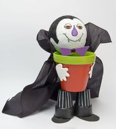 Count Dracula Treat Pot ~ Turn plain clay pots into an adorable Halloween treat holder in a few fun steps.