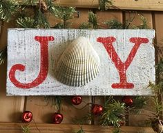Simple Joy Christmas Sign with Shell.... http://www.completely-coastal.com/2016/12/simple-coastal-christmas-decor-ideas.html