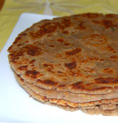 A recipe for a delicious and flaky Arbi Paratha, a gluten-free Indian flatbread stuffed with a mixture of colocasia and spices.