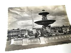 Unused 1930s postcard of Place de la Concorde in Paris, France. Behind the fountain, the obelisk which Napoleon brought from Egypt can be clearly seen dominating the sky. The very large building behind it - or buildings, in fact - is the world famous Louvre museum. This area is steeped in history, as it was an execution site during the French Revolution; King Louis XVI and his queen Marie Antoinette were led to the guillotine in this square.  I believe that this wonderful piece of hi...