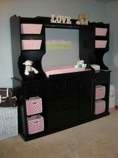 Old entertainment center made into baby change station with storage