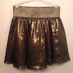 Gold Shimmery Skirt Perfect for any Holiday or New Years gathering! (Elastic waist band). Worn once. Forever 21 Skirts Mini