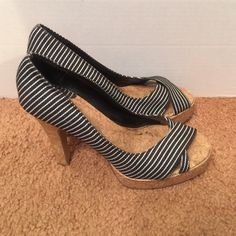 "Adorable black and white hills. These are adorable hills. Black & white in color, cork screw color bottoms and bills. Hills are: 5"". Charles Albert Shoes Heels"