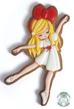 Galleta de glasa con forma de niña bailarina.