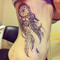 Dreamcatcher tattoo on ribs