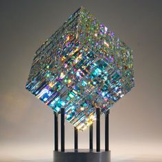 Contemporary Glass Sculptures by Fine Art Glass Artist Jack Storms. Fine art glass designs created from dichroic glass encased into pure lead crystal.