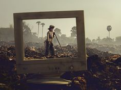 Picture of a child standing on a garbage pile in Cambodia