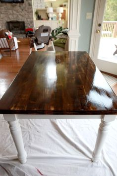 Dining table makeover- oil based polyurethane. Yes, it is annoying that your foam brush dries before you can do two coats…but it is well worth it. love this Zinsser type that boasts that it will warm up your wood.If it is a stained piece of furniture (like this one), SAND between the coats of poly. Use, and watch yourself here because this is hard to remember, use…BETWEEN-COAT SANDPAPER.