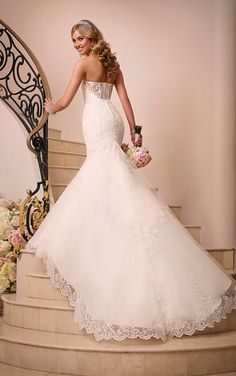 Stella York gowns available at Spotlight Formal Wear lace fit n flare with cut off sheer back Wedding Gown Collection