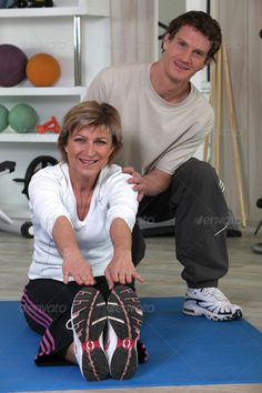 Middle-aged woman with personal trainer ...  adult, adults, assisted, athletic, body, club, coach, excited, exercise, female, fitness, gym, handsome, health, help, instructor, leisure, lifestyle, lifting, male, man, muscles, muscular, people, personal, positive, power, recreation, sport, sportive, strength, support, team, trainer, training, two, vertical, weight, woman, workout