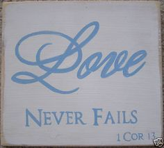 LOVE NEVER FAILS Christian Sign Plaque in Rustic Wood