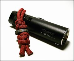 https://flic.kr/p/HyoXri | ABoK #784 Paracord Lanyard | The diamond and crown knot, tied on opposing sides of a twin hole flamed titanium paracord lanyard bead, attached to my Sunwayman R10R LED flashlight.  The daily stuff of an EDC pocket dump.  stormdrane.blogspot.com/2016/05/lazy-sunday-in-may.html