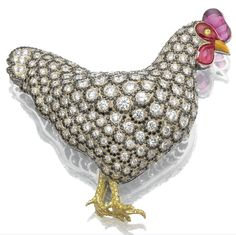 Ruby, enamel, and diamond hen brooch by Michele Della Valle. http://www.sfbayhomes.com #sfbayhomes.com