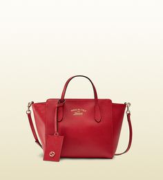 Gucci - gucci swing mini leather top handle bag. A girl can dream...