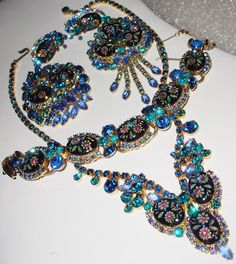 IS VINTAGE JEWELRY A GOOD INVESTMENT? The answer to that question varies. It's a good investment if:     1) it's a designer piece  2) the designer's jewelry is scarce  3) the condition is excellent  4) if you're buying to wear, invest or sell    This is a superb designer piece in the Juliana style from DeLissa & Elster. All stones are present, the colors are outstanding, and the design is unique.  Making it even more valuable as an investment is the fact that it's a 5-piece parure!