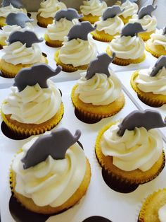 Elephant cupcake toppers. Yellow grey and white baby shower theme.